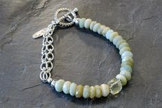 Spring Has Sprung!! Here is one of our newest Spring Designs, using faceted, green aquamarine and a lemon quartz cube. The detailed chain and the toggle clasp are sterling silver.  A great way to add a little spring to your wardrobe! 20% off our entire website when you use promo code: gift20