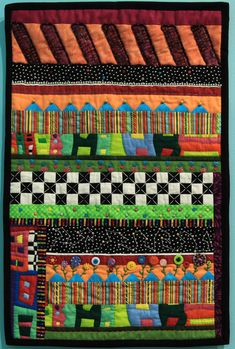 """Wall Quilt 9, """"Crazy Therapy"""" by Elizabeth Hawker  """"Although this is not a typical 'crazy quilt,' it does include different fabrics and fabric placement. I enjoyed trying some hand quilting and adding various embellishments. The quilt gave me an opportunity to try decorative stitching for the first time and include buttons from my 'excessive' collection. I thoroughly enjoyed the relaxing time spent on it, adding whatever seemed to work."""" Hand Quilting, Capital City, Different Fabrics, Opportunity, Embellishments, Stitching, Give It To Me, Therapy, Buttons"""