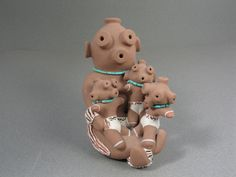 Isleta Pueblo Mudhead Storyteller Holding Three Children | Chris Teller