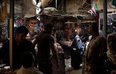Photo: Adam Ferguson for The New York Times. A market in Baghdad last week.