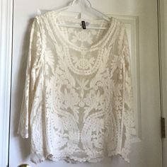 Long sleeve lace shirt Channel your inner 70s vibes in this top! Great shirt, but everytime I put it on I find it fits me weird! It's sized 10 BUT it runs small in the arms and in the chest. Would looks great with a maxi skirt, jeans, or a mini suede skirt. Pretty much anything! Is see thru but would look great with a bralette. Shirt could even be layered over it! Small pink stain but not visible when shirt is worn Divided Tops