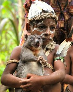 """mysleepykisser-with-feelings-hid:  """" Kaluli Tribe Boy  by Blake Everson  Kaluli Tribe boy holding a cuscus at a hunting camp near Mount Bosavi  (more faces around the world here)  """""""