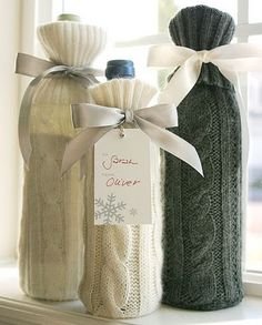 Use the sleeve from a thrift store sweater to cover a bottle. Cute winter idea!