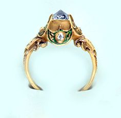 15th Century [!?] engagement ring set with   a natural diamond octahedron  in a handmade carved gold and enamel setting.    German.