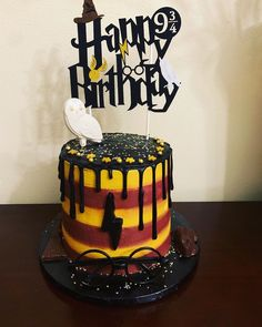 Happy Gryffindor birthday to Chloe! Our entire family was so excited to make this Harry Potter Vanilla Nutella drip cake! Who's side are… Harry Potter Theme Cake, Harry Potter Torte, Harry Potter Desserts, Harry Potter Cupcakes, Harry Potter Bday, Harry Potter Birthday Cake, Harry Potter Food, First Communion Cakes, Anniversaire Harry Potter