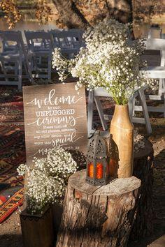 Stumps, Unplugged Signs, Wooden Vases, Orange Lantern, and Rugs Boho Wedding, Wedding Ceremony, Wedding Venues, Reception, Orange Lanterns, Wooden Wedding Signs, Wooden Vase, Tree Lighting, Twinkle Lights