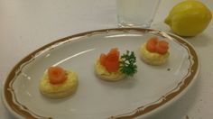 Lemony Salmon Appetisers. :) Puff pastry, this lemon infused savoury cheesecake mixture and garnished with salmon roses. I don't even know.