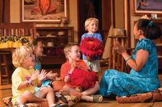 Kids learn to sing songs and dance with real hula impliments