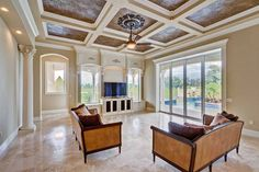 Adjacent to the kitchen is an impressive family room with views of the pool and lake.