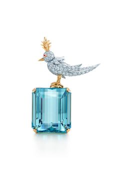 Tiffany & Co. Schlumberger® Bird on a Rock clip with diamonds, a sapphire and a 106.94-carat aquamarine. #TiffanyPinterest