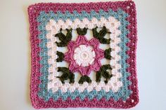 Alternate solid crochet squares with these flower granny squares for a very floral afghan. Pattern found on Ravelry.