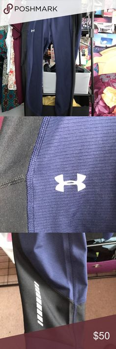 Under Armour leggings navy blue UA leggings with black along the side of legs. back zipper included on side of leg and a small pocket on the back for a credit card or keys. stretchy, cozy leggings. bundle these with my nike cropped leggings and you'll have yourself a like-new duo of workout pants. you won't be disappointed with these. same description as my Nike Epic Lux listing.These are too stretchy for my liking. i like my workout pants tiiiight. 💛smoke - animal - free environment…