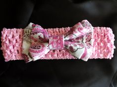 Double pink and grey paisley print. Shown on a light pink band. $10.00