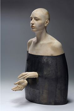 """Bruno Walpoth creates intriguing human sculptures made of wood. The textural imperfections of the sculptures give a figurative spirit to the trees from which it came. Walpoth uses semi-translucent paint to coat his works, ensuring that the wood grains stay visible. There is a sense of life and humanity in the figures which often seem quite pensive and deep in thought."" http://www.ignant.de/2014/02/25/human-sculptures-by-bruno-walpoth/"