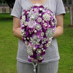 Are you looking for an alternative to real flowers for your bouquet? This brooch bouquet is absolutely stunning and will take your breath away! White Peonies Bouquet, Purple Bouquets, Pink Bouquet, Blue Wedding Flowers, Bridesmaid Flowers, Purple Wedding, Bling Wedding, Wedding Brooch Bouquets, Flower Bouquet Wedding