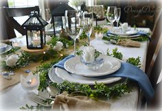 Dining Delight: White Roses & Black Lanterns Tablescape