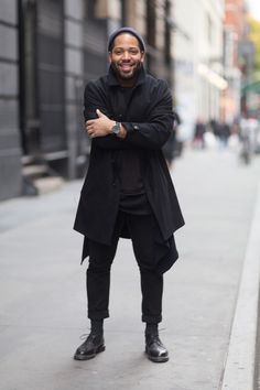 Street Style: A Fashion Photographer's All-Black Layers: Jacket, pants, mesh tank around waist from Public School