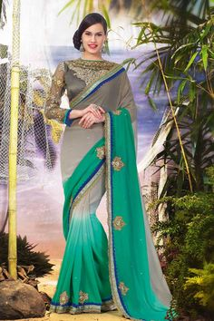 Green Grey Georgette Saree with Grey Blouse Price:-£59.00 Andaaz Fashion presents new arrival designer Green Grey Georgette Saree with Grey Blouse. Sarees comes with Designer Pallu, Boat Neck Blouse, and Full Sleeve. It is embellished with Resham, Stone, Zari and Embroidery. This is prefect for party wear, wedding, festival and ceremonial http://www.andaazfashion.co.uk/green-grey-georgette-saree-grey-blouse-dmv7911.html