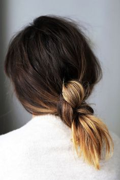 The Messy Knot - If you can't decide between a ponytail and bun, why not combine both into a cool, textured knot? Gather hair at the nape of your neck, then create a series of large knots, leaving your ends free. Secure by tuckinga clear elastic at the base of the last knot.