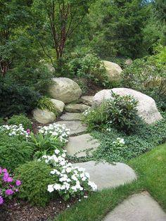 Nice rock placement alongside a stone path