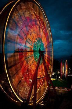This is a long exposure shot of a Ferris wheel. This is one of the coolest effects! It's pretty neat you can do this without the use of Photoshop!