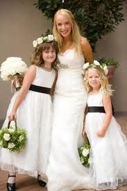 flower girls in simple white with lovely white and green floral purses