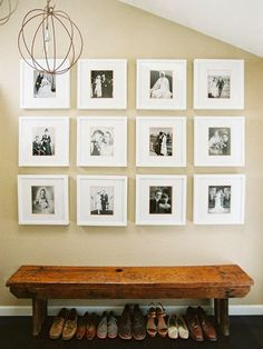 love the black and white family wedding photos framed and matted in white - very modern