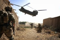 A Royal Air Force CH-47 Chinook helicopter arrives to extract troops at the end of an operation in Afghanistan.