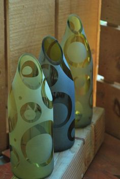 Previously decorative bottles can be transformed into vases by cutting their necks off – this end much better than it sounds. Choose sanded bottles, in colors if you can. Slide the cutter diagonally for a more interesting effect.