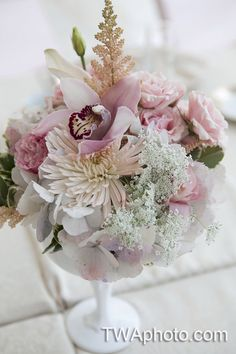 This floral arrangement would be perfect for an outdoor wedding ceremony.  #pink #weddingflowers  www.twaphoto.com