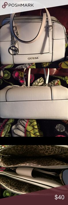 GUESS HANDBAG Off white. Almost new. Clean inside and out. 3 separate compartment plus zippered compartment inside middle. Magnetic closure. 4 slip pockets. No wear anywhere. Used only a few times. 12 x 9 x 4. 8 inch strap drop in middle position. Can be longer or shorter. Will fit on shoulder. Reasonable offers please. Guess Bags