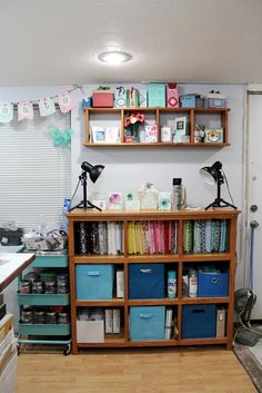 Here's a great sewing space tip for storing your 1 yard or less cuts of fabric. Use archival comic book backing boards to neatly wrap fabrics to store on shelves - you'll be able to quickly see the colors and prints.