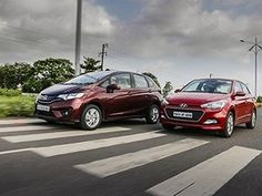 The All New 2015 Honda Jazz is finally here. We know it is rich on space and practicality but can it beat the popular Hyundai Elite Honda Jazz, Automobile, Wheels, Projects, Car, Log Projects, Motor Car, Autos, Cars