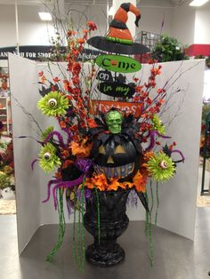 """Bewitched Entry Way Indoor/Outdoor Halloween Floral Arrangement. PUMPKIN LIGHTS UP!!! DO YOU DARE """"COME IN?""""   By Christian Rebollo"""