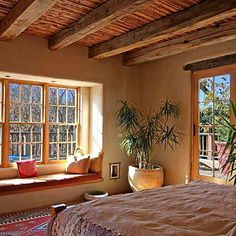 classic Santa Fe style bedroom in earthy colors, weathered wood and the kind of comfortable rustic bliss that comes with desert light bouncing off terracotta plaster walls - Design Ideas, Pictures, Remodel, and Decor