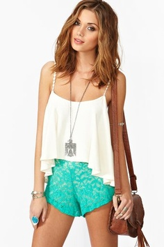 outfit: white thin-strapped cropped frilly singlet, turquoise lace minishorts, silver pendant necklace, silver bracelet, turquoise ring, tan satchel