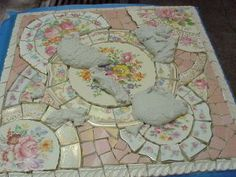 BROKEN CHINA MOSAIC HOW TO: HOW TO GROUT YOUR MOSAIC SURFACE - thinking this might be the perfect backsplash and possible table re-do