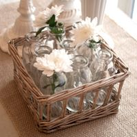 Got only a few flowers? singly placed in bottles assembled in a nice basket they become a full statement piece. .$15.95 Laurie Anna's Vintage Home