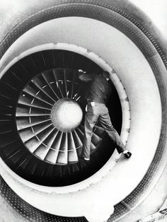 Mechanic checks the intake blades of a Lockheed C-5 Galaxy Transport Plane, from New York Times, Nov. 16, 1969 article on the military industrial complex.