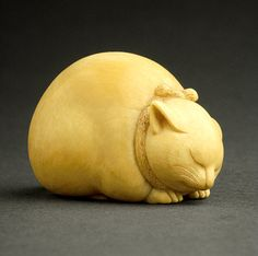 Sleeping Cat, mid- to late 19th century    Kaigyokusai (Masatsugu) (Japan, Osaka, 1813-09-13 - 1892-01-21)    Netsuke, Ivory with sumi, red pigment    AC1998.249.80 Los Angeles County Museum of Art    via lilacs and wild geese.