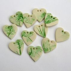 Heart shaped foliage porcelain buttons. From MelissaCeramics on Etsy £10 for five.