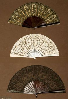 """Three Lace Fans, 1850-1880; Two with tortoise sticks and black Chantilly lace: One 10.5"""" and 1 11.25""""; one with abalone sticks and guards, cream Brussels lace leaf"""