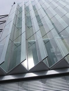 Oskar von Miller forum sawtooth double skin facade which is used to diffuse daylight as well as for natural ventilation.