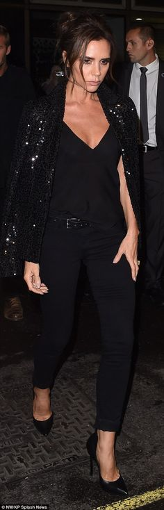 Any colour as long as it's black: The former Spice Girl looked sleek in black skinny jeans...