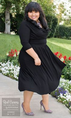 "Wholesale Associate and Real Curve Cutie Jasmine (5'3"") is flawlessly adorable in our plus size Draped in Class Dress. Fun shoes go perfectly with her chic hair, while the statement necklace complements this"