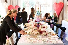 Baby Shower party photography coverage near London in Surrey showing party decor and table set-up in pink, Alice in Wonderland, rose floral theme, in expectation of baby girl.