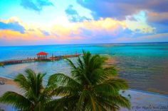 Ambergis Caye, Belize at sunset. Just a 15-minute flight from Belize City.