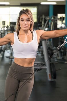 It's been said that Cassandra Martin is a beauty who trains like a beast. Yup. Get ready for a non-stop, front-to-back shoulder workout that'll run you ragged.