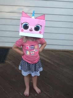 The Lego Movie Unikitty costume hat I made for my little sister. I made it using a cardboard box, clay, paint, a headband, hot glue, and scissors.