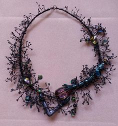 Small Arms Branch necklace- hand twisted wire with glass seed beads and glass crystals with doll arms. Gilding The Lily by Candace Eck